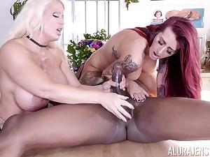 Tattooed Alura Jenson and Tana Lea share a big black cock and its cum