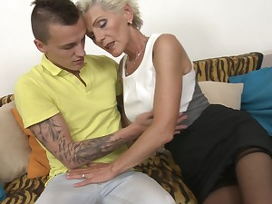 Short haired granny Irenka S. gets her tits licked together with pussy fucked