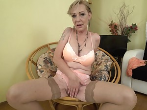 Mature blonde granny Maris pounds will not hear of pussy in stockings