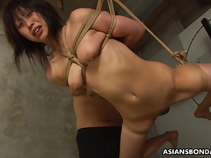 Submissive Asian bimbo Kana Sato gets roped with an increment of sucks cock