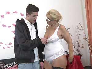 Nerdy mature blonde MILF Regina T. sucks and fucks with glasses aloft