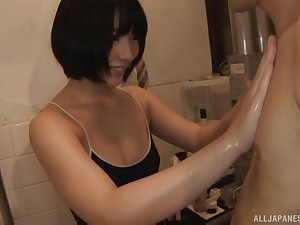 Short haired Japanese babe Abeno Miku blows cock in the office