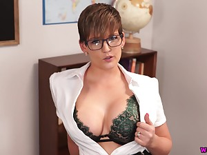 Nerdy office lady Hannah Brooks stands in the sky knees to wank a fake cock
