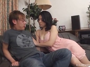 Horny Japanese mature Miwako Yamamoto gives a handjob to will not hear of hubby